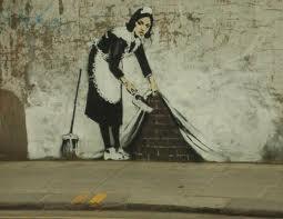 Sweep it under carpet . Banksy