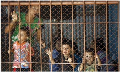 refugees behind bars